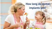Girl feeding grandmother with dental implants