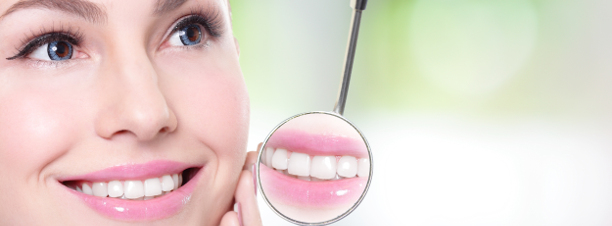 Lady smiling into mirror - cosmetic treatments